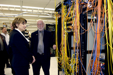 Mr. Gerry Miller, Executive Director, Information Services & Technology, shows Minister Yelich around the University of Manitoba's HPC Facility.