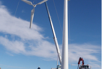 Installation of wind turbine to generate power for the arena's artificial ice plant in Hazlet, SK
