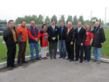 MP Rob Anders (C) surrounded by the Greater Calgary Amateur Athletic Football Association Board of Directors in front of the projects main sports field.