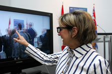 Minister Yelich tries out the new 3D equipment at Emily Carr University of Art and Design.