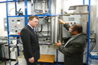 Photo of Minister John Baird learning about coal gasification technology.