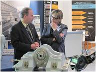 Photo of Minister Yelich talking with Kevin Russell from ASCO Aerospace Canada Ltd. (ASCO).