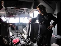 Photo of Minister Yelich examining the cockpit of the Lockheed Martin CC-130J Hercules.