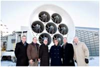 Photo of Wind Tunnel Fans at the testing centre [L-R: Michael Kulkelko (WestCaRD), Brent Ostermann (StandardAero), Ross Hornby (GE Canada), Minister Yelich, Kim Olson (StandardAero), Vic Gerden (WestCaRD).
