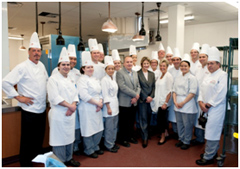 Photo of Minister Yelich and Red River College executives with students of the College's Culinary and Hospitality Program at Paterson GlobalFoods Institute in Winnipeg.