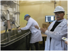 Photo of Dr. Tom Scott, Research Chair, Feed Processing Technology, University of Saskatchewan, demonstrating how the BoMill Seed Sorter operates at the Canadian Feed Research Centre.